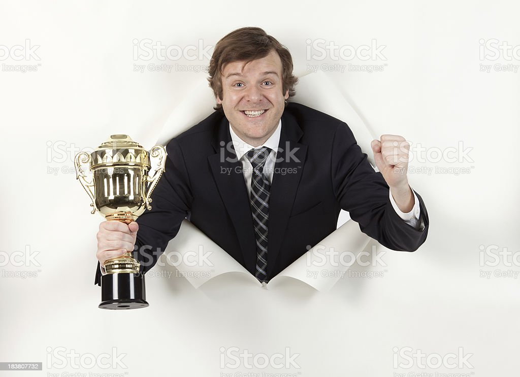 Successful businessman with a trophy royalty-free stock photo