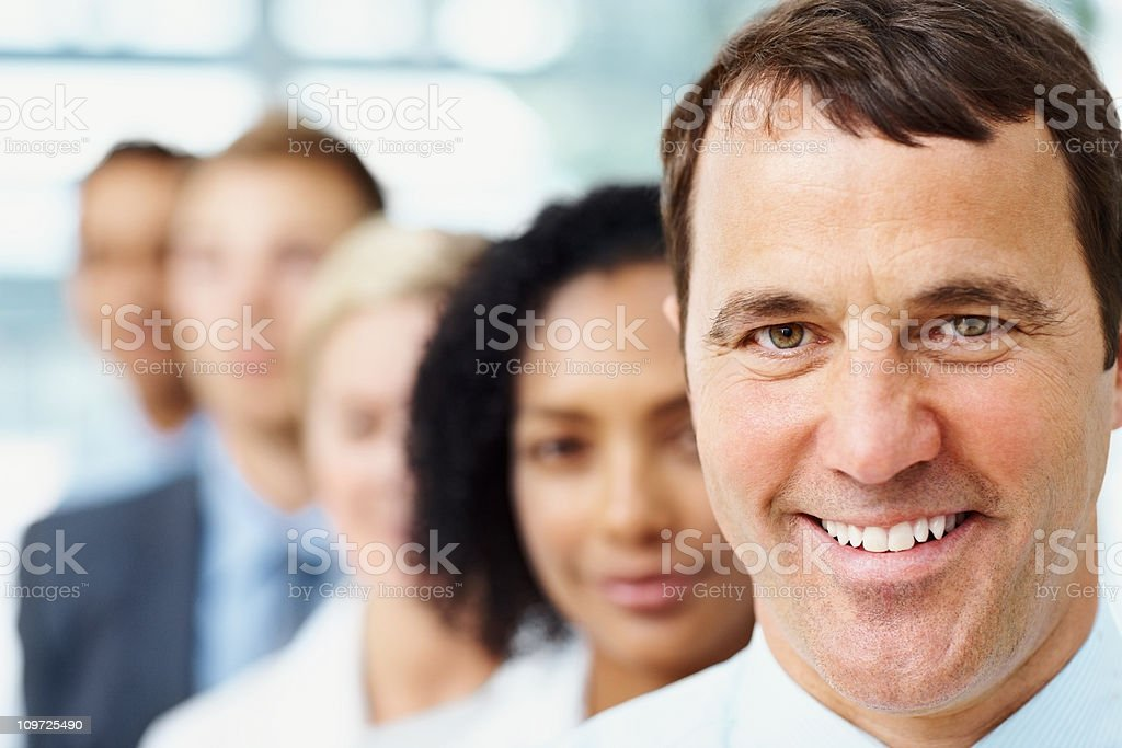 Successful businessman with colleagues in a line royalty-free stock photo