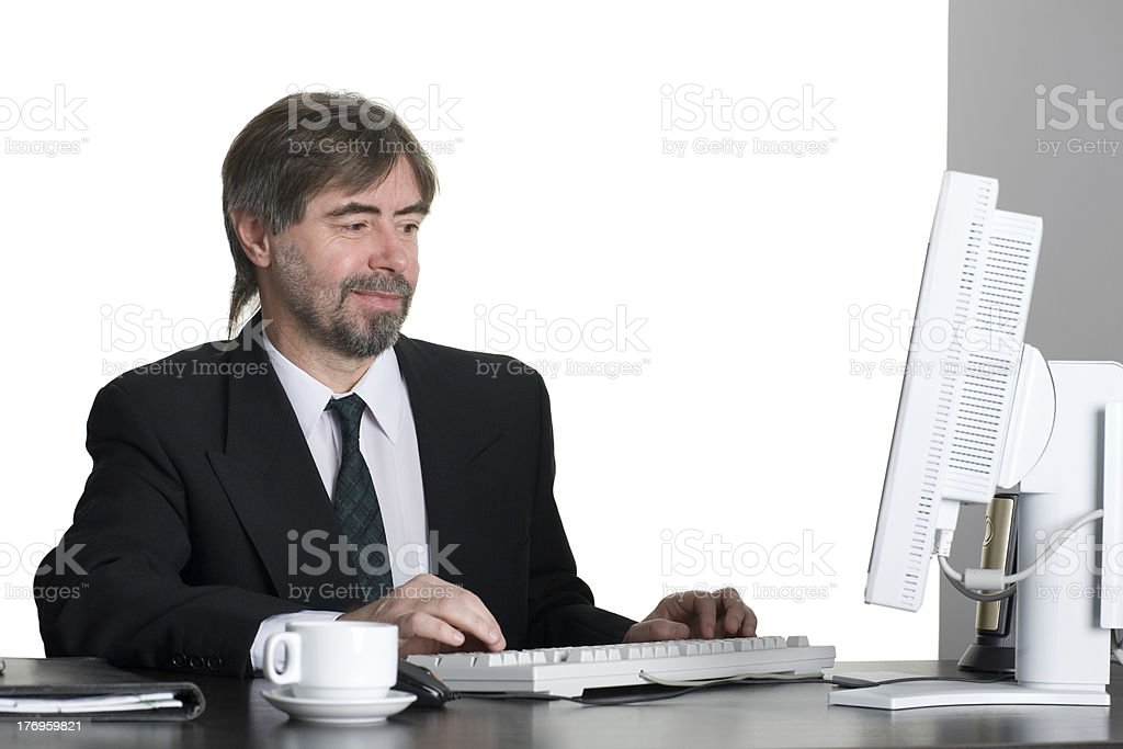 Successful businessman with computer royalty-free stock photo