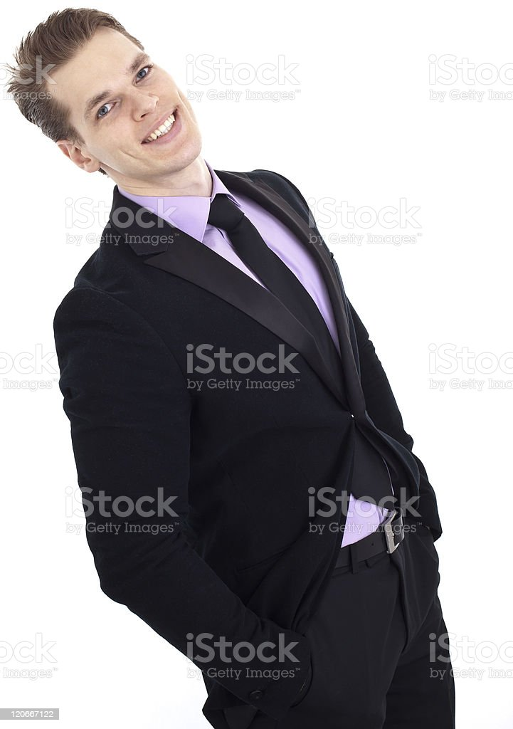 Successful businessman with hands in pockets laughing, isolated royalty-free stock photo