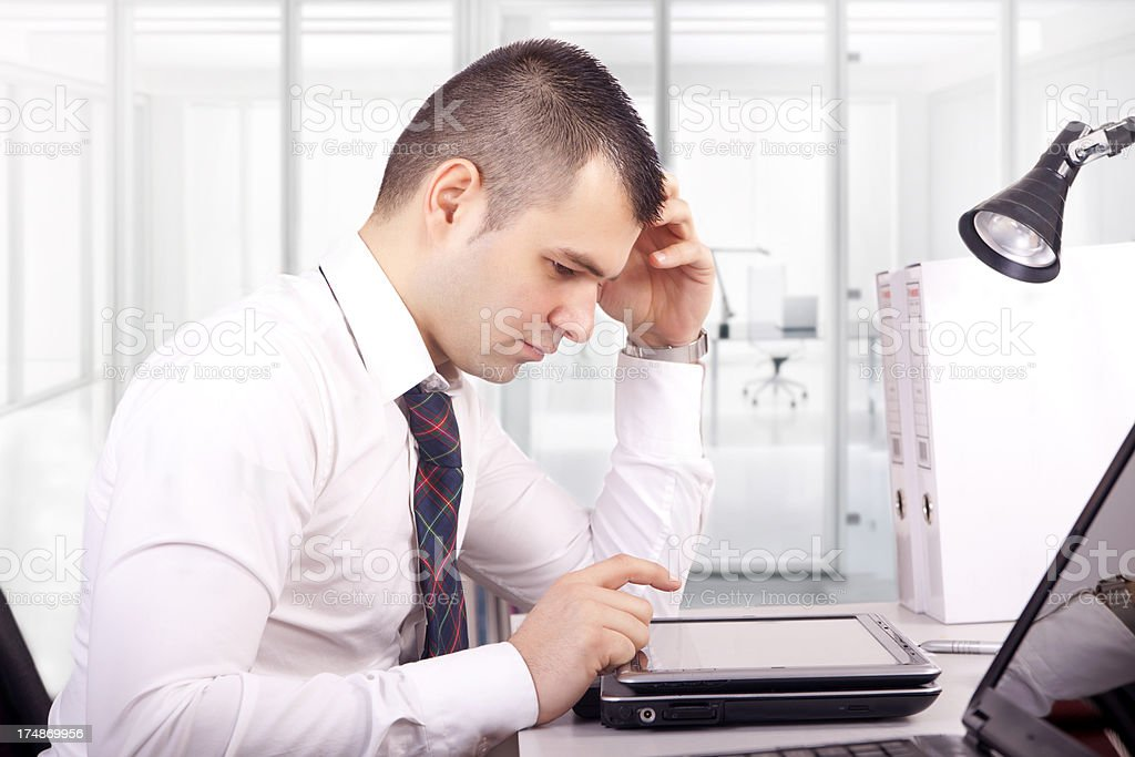 Successful businessman working in his office royalty-free stock photo