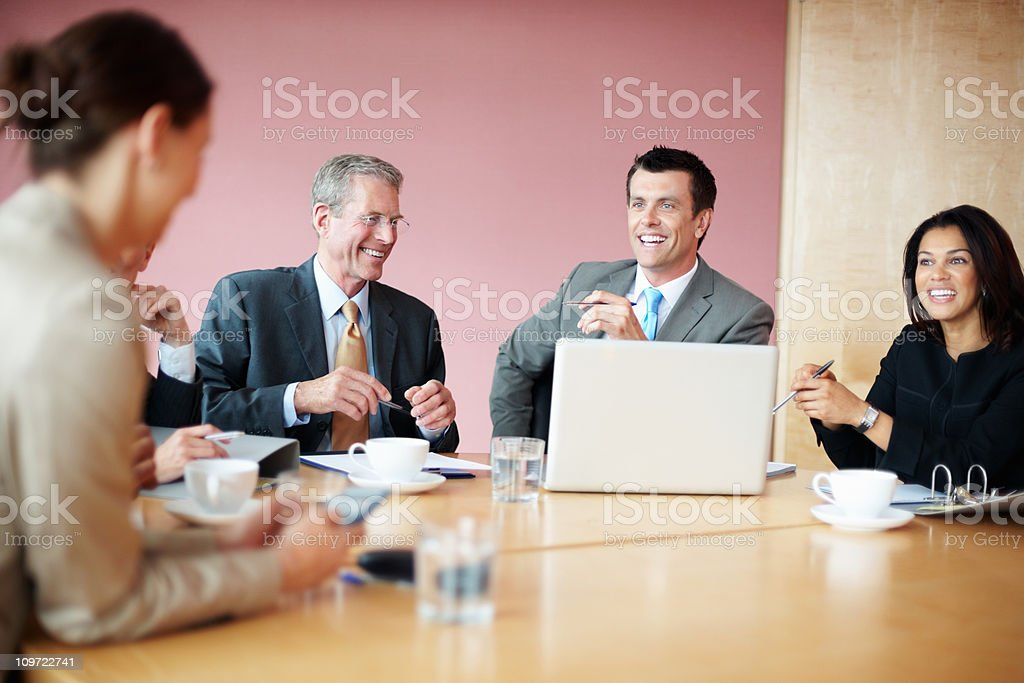 Successful businesspeople having meeting with a laptop royalty-free stock photo