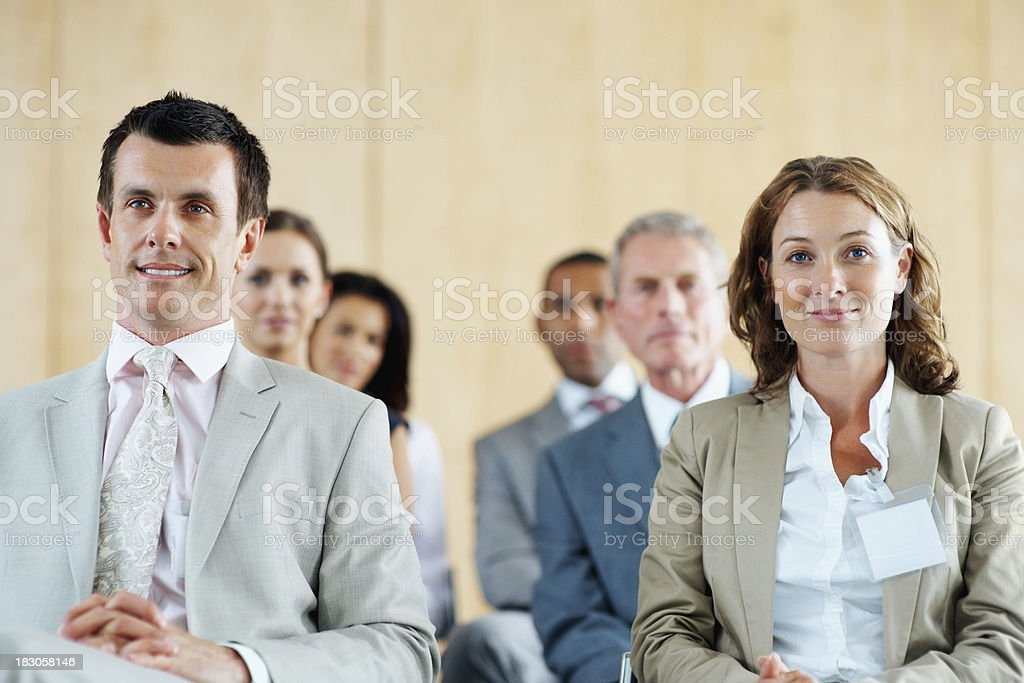 Successful businesspeople sitting in row at a seminar royalty-free stock photo