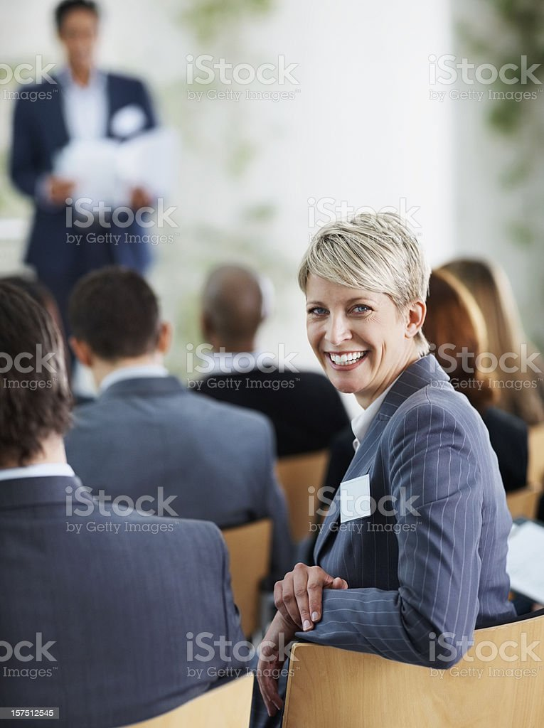 Successful businesswoman at a seminar royalty-free stock photo