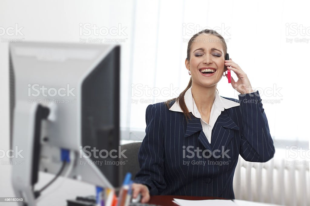 Successful businesswoman calling royalty-free stock photo