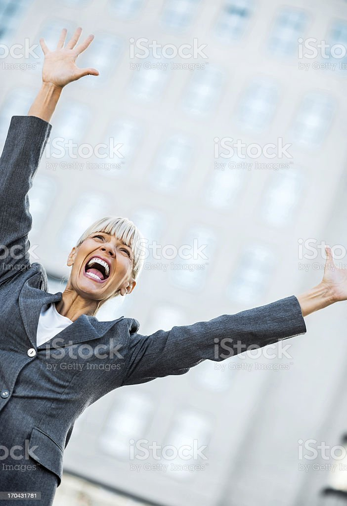 Successful businesswoman celebrating her success. royalty-free stock photo