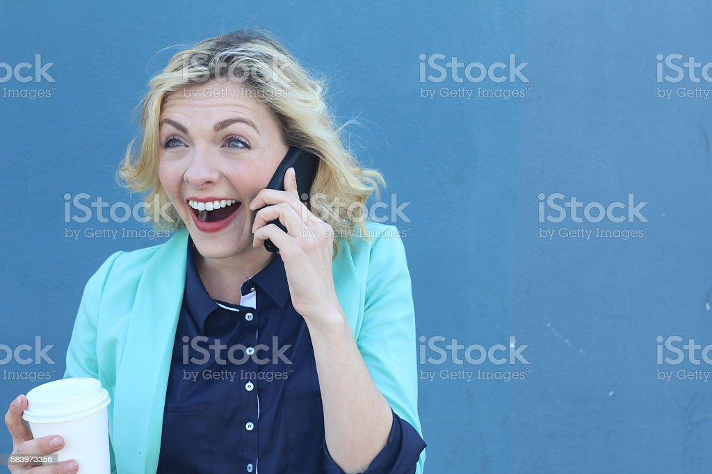 Successful businesswoman getting good news by phone stock photo
