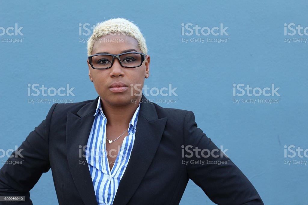 Successful businesswoman in suit with arrogant expression stock photo