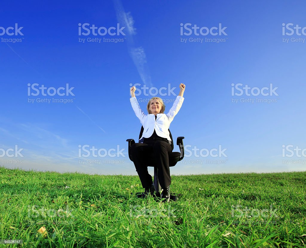 Successful businesswoman on meadow. royalty-free stock photo