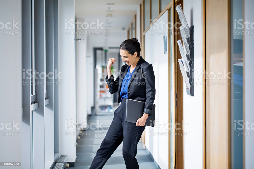 Successful businesswoman punching air stock photo