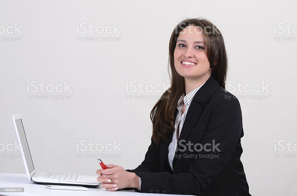 Successful businesswoman using laptop for startup business stock photo
