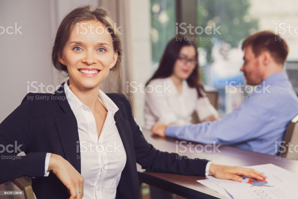Successful Businesswoman with Colleagues in Office stock photo