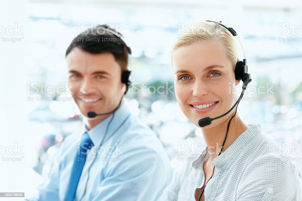 Successful call centre executives wearing headset, smiling royalty-free stock photo