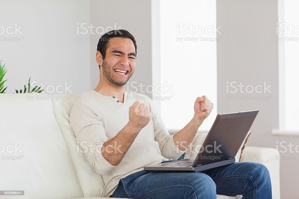 Successful casual man cheering stock photo