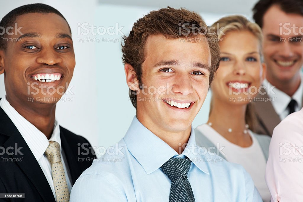 Successful diverse business group standing together stock photo