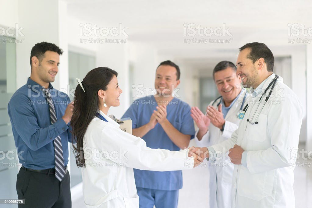Successful doctor getting a promotion stock photo