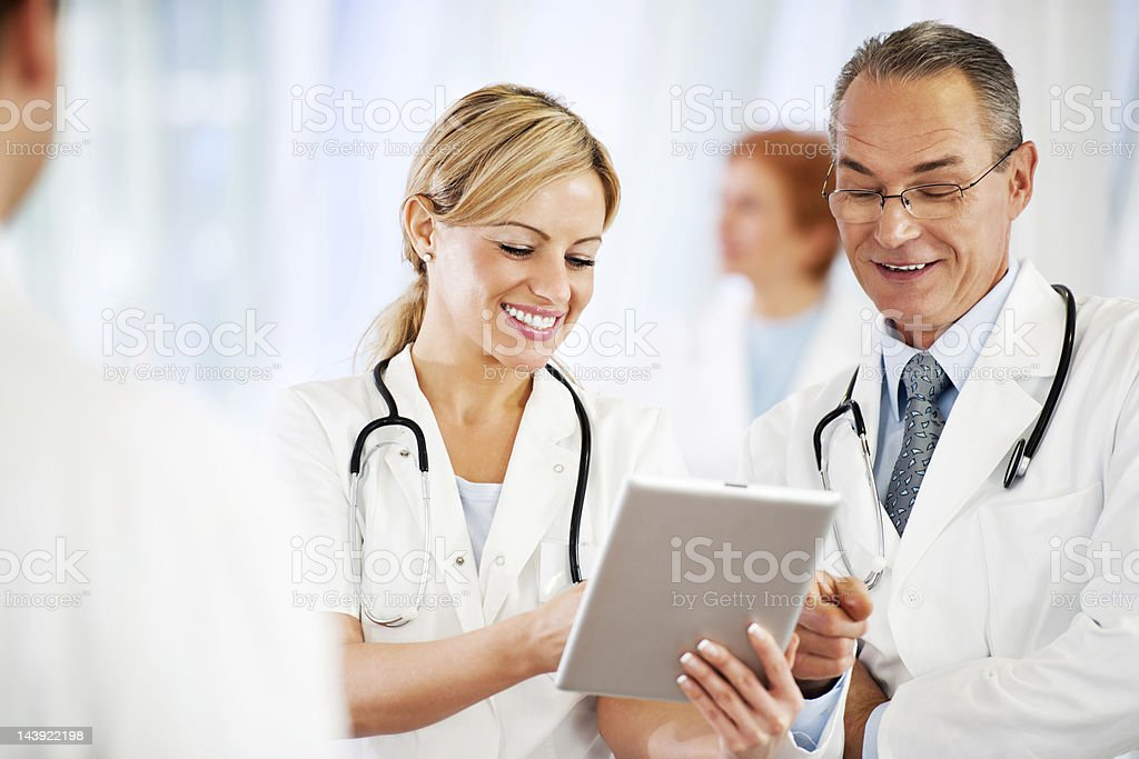 Successful doctors using together a touchpad. royalty-free stock photo