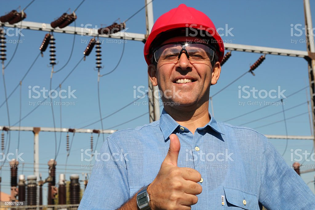 Successful Engineer in Red Helmet Showing Ok Sign stock photo