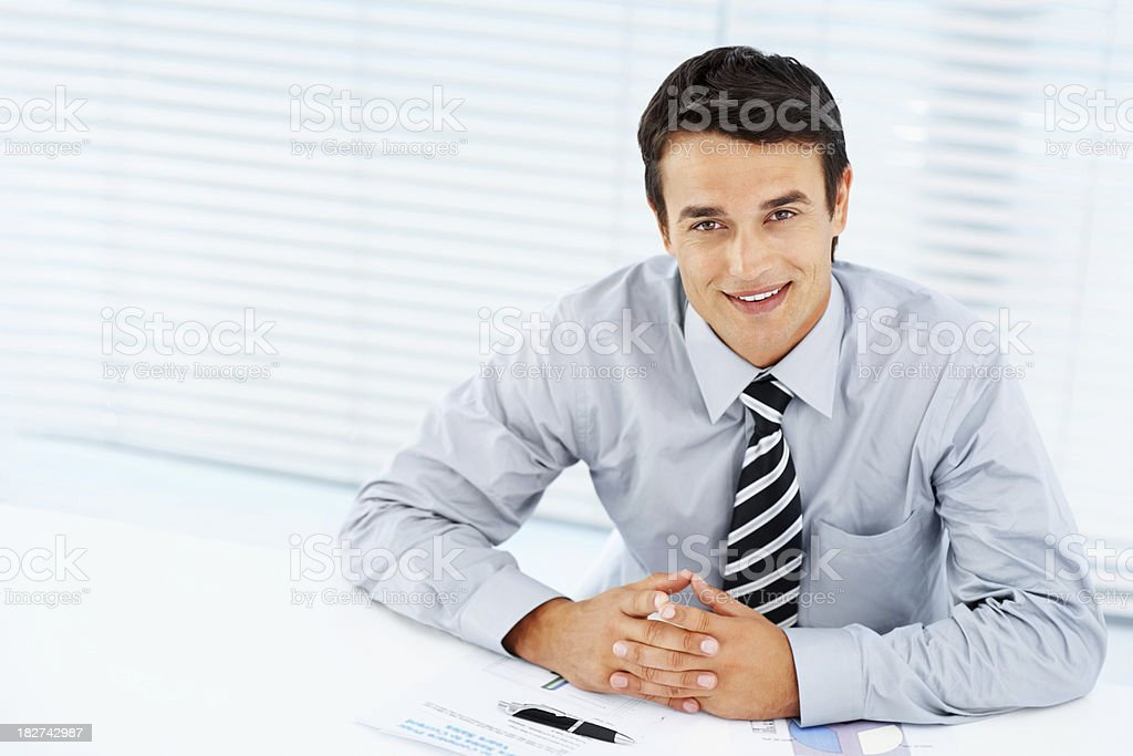 Successful executive sitting at work desk- copy space royalty-free stock photo