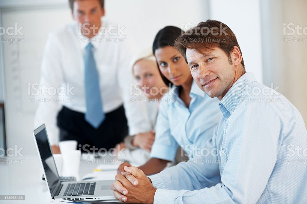 Successful executive with laptop during a presentation stock photo