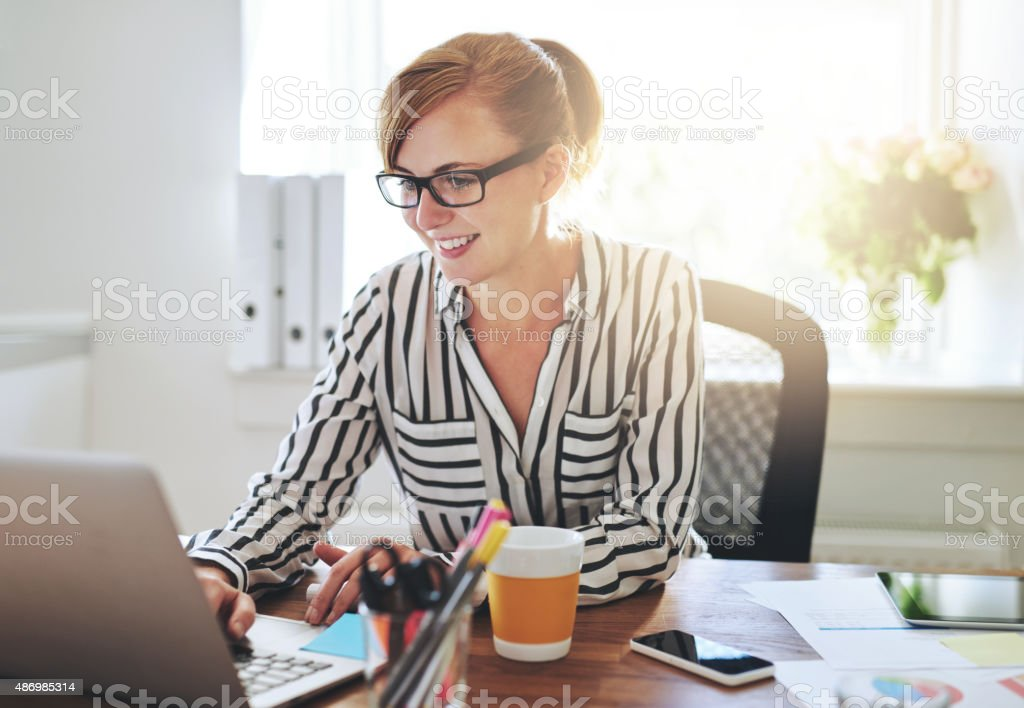 Successful female entrepreneur with a new business stock photo