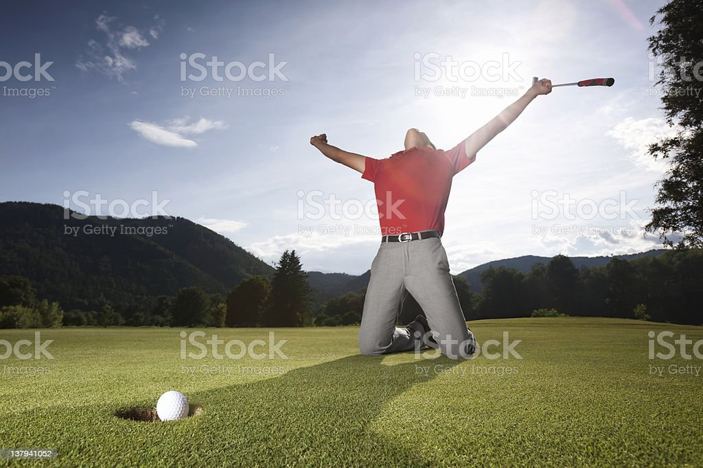 Successful golf player on green. royalty-free stock photo