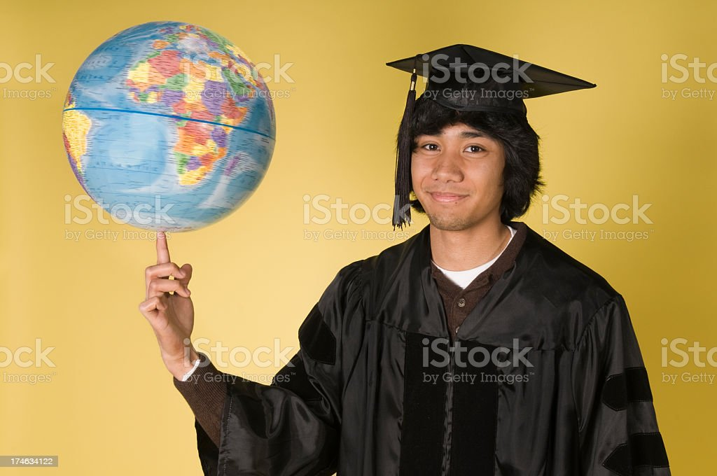 Successful Graduate Spins the World on His Finger royalty-free stock photo