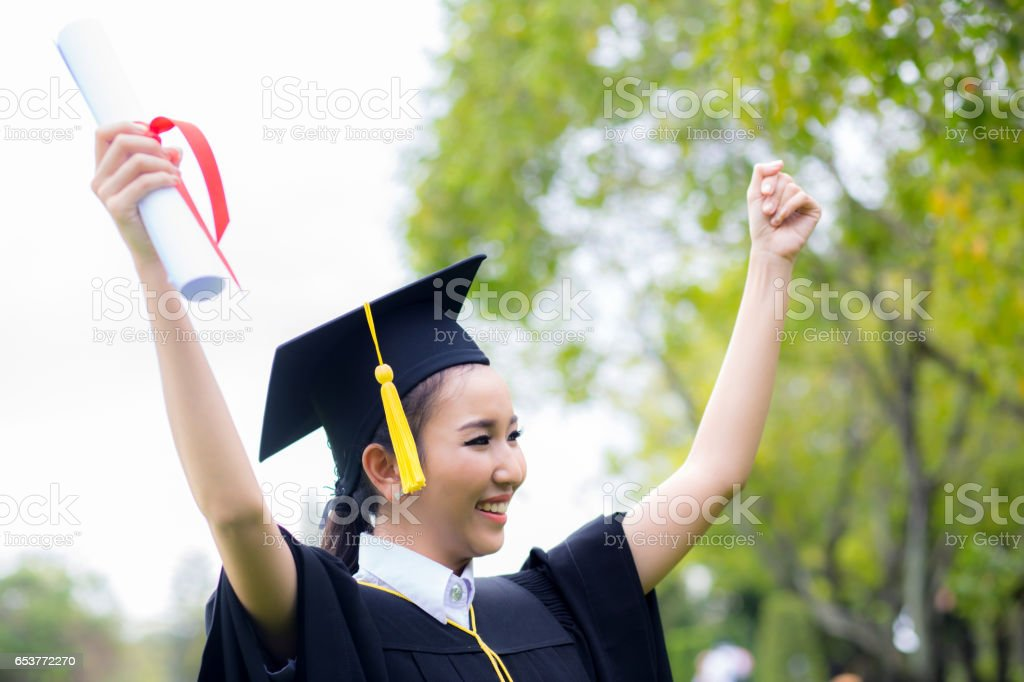 successful graduating student with nature background, Happy graduated student girl, congratulations, concept education stock photo