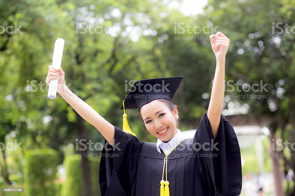 successful graduating student with nature background stock photo