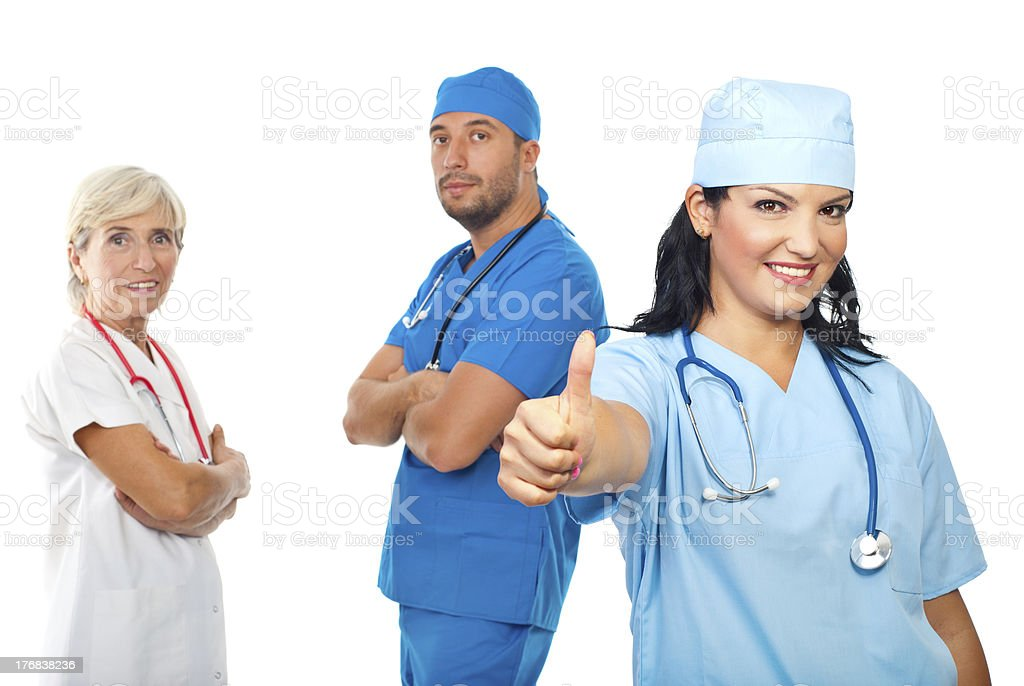 Successful group of doctors give thumbs royalty-free stock photo