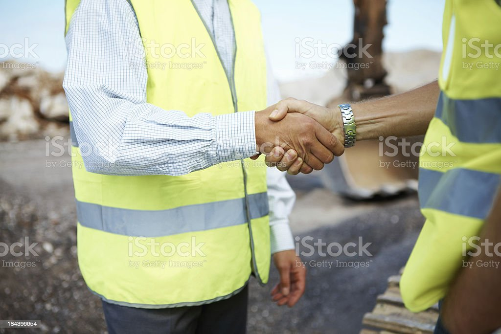 Successful handshake deal at construction site royalty-free stock photo