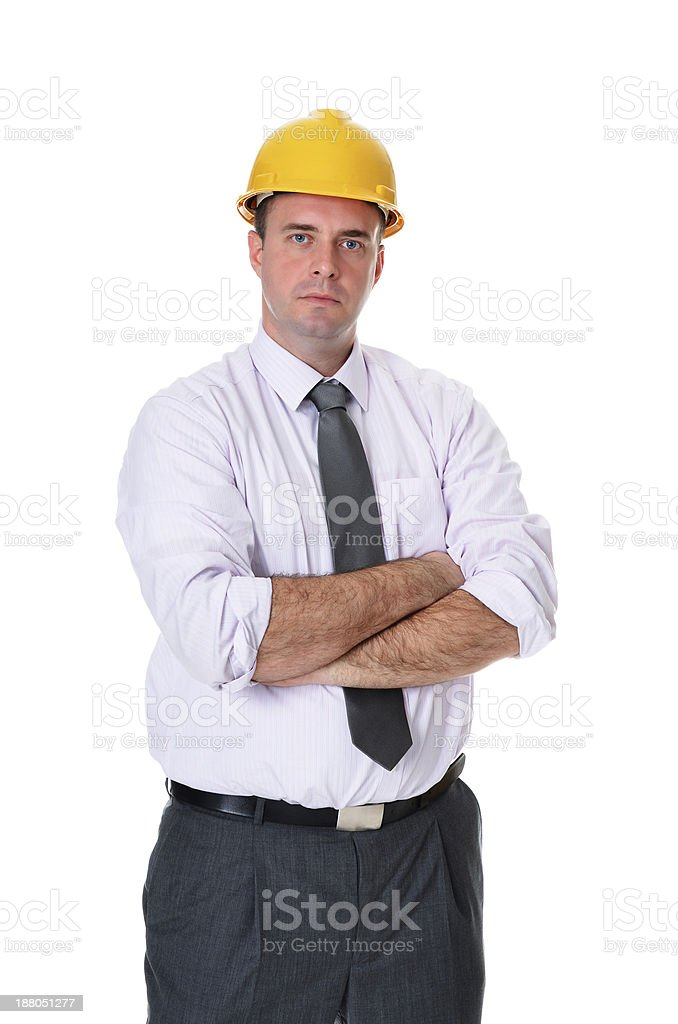 Successful handsome caucasian blue eyed engineer with arms crossed royalty-free stock photo