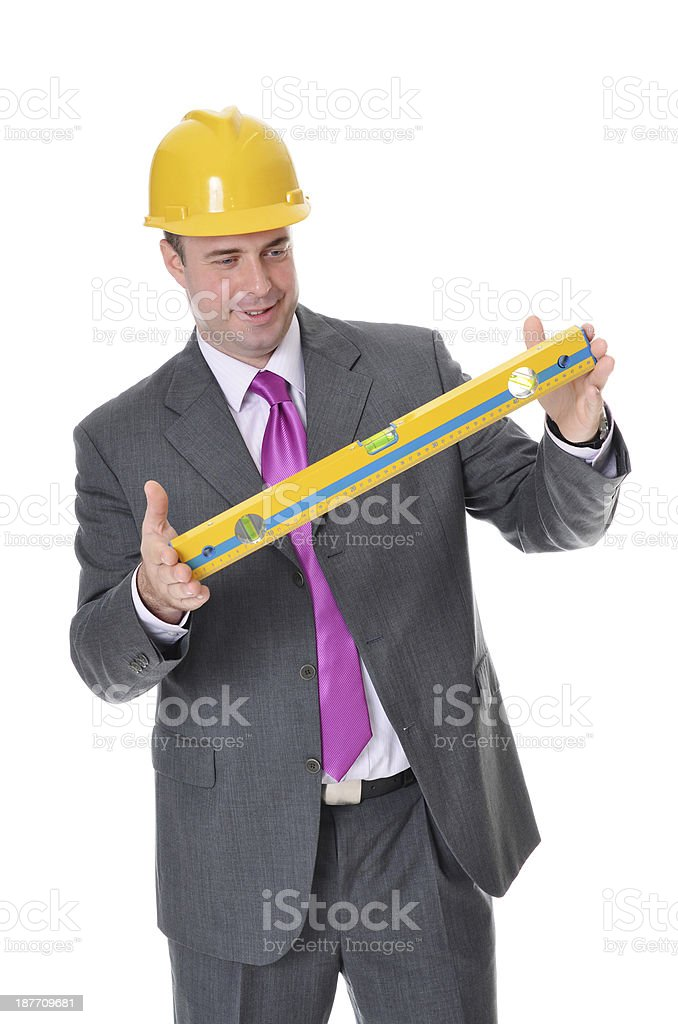 Successful handsome caucasian professional engineer with hardhat and meter stock photo
