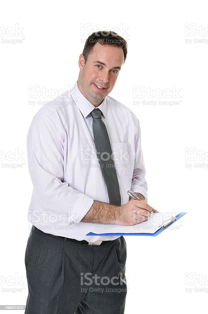 Successful handsome formal businessman writing notes on isolated white background royalty-free stock photo