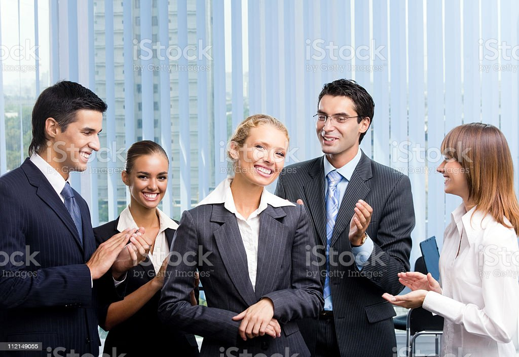 Successful happy businesswoman and businessteam at office royalty-free stock photo