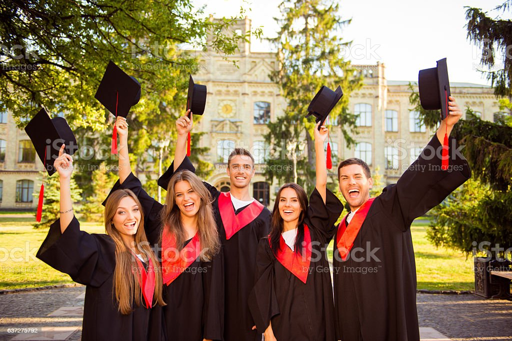 successful happy five graduates in robes together rise mortar-board stock photo