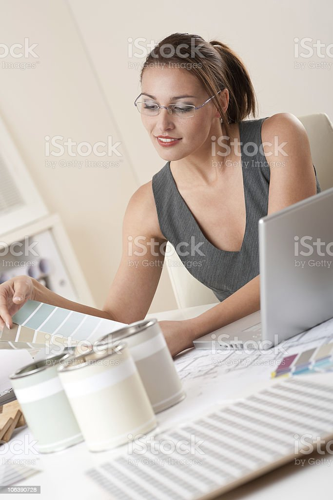 Successful interior designer woman working at office with laptop royalty-free stock photo