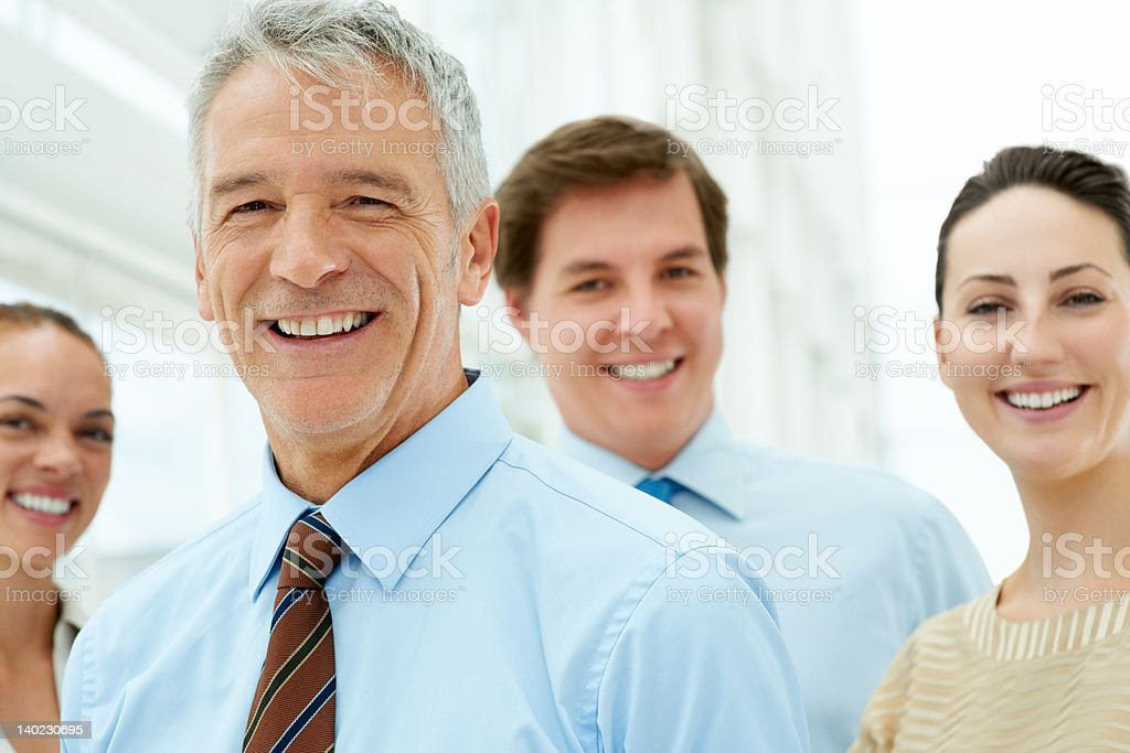 Successful leader with his team smiling stock photo