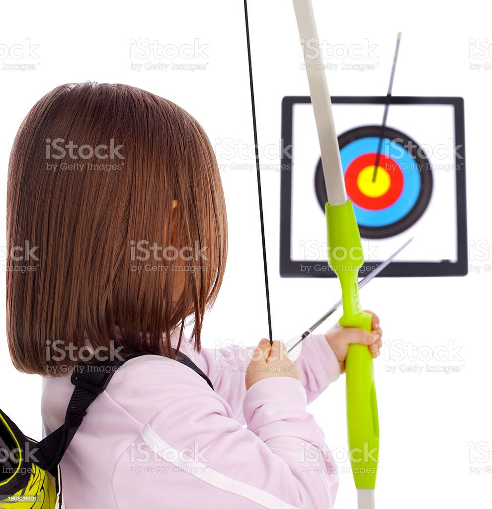 Successful little archer girl throws arrows royalty-free stock photo