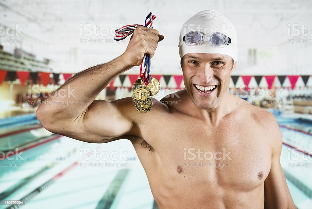 Successful male swimmer with his medals royalty-free stock photo