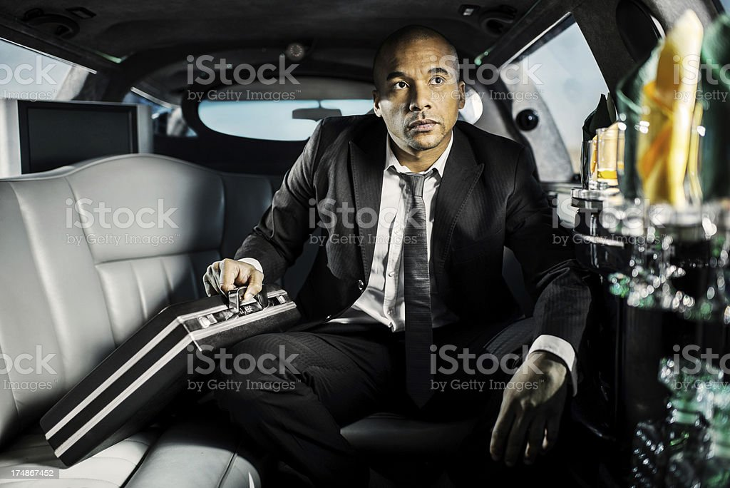 Successful man on a business travel in limousine. royalty-free stock photo