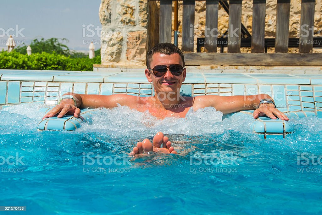 Successful man relaxing pool jacuzzi outdoor  spa resort enjoying life stock photo