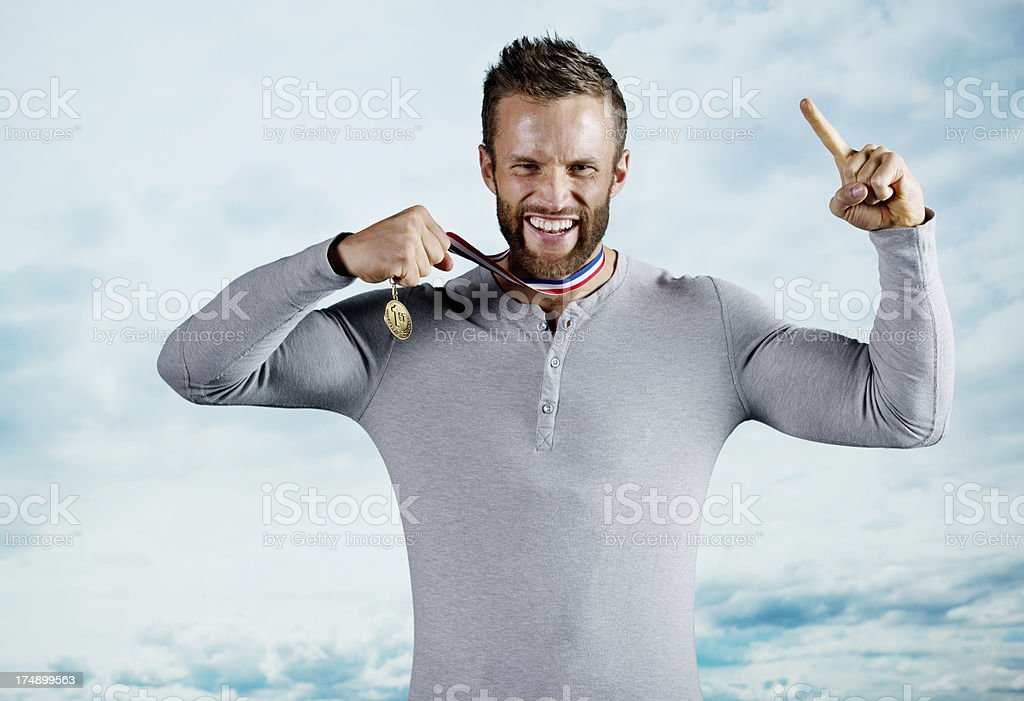 Successful man showing his medal royalty-free stock photo