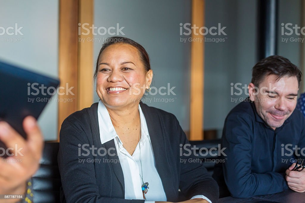 Successful Maori Pacific Islander Business Woman Leading a Team Meeting stock photo