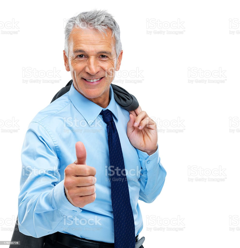 Successful  mature businessman gesturing a success sign stock photo