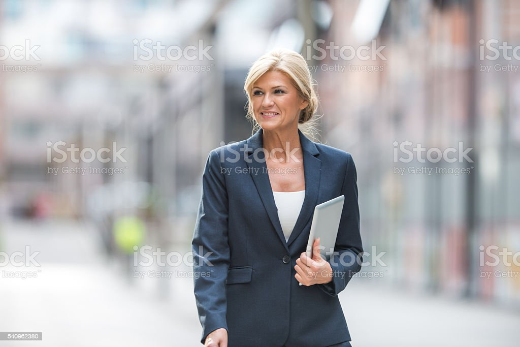 Successful mature businesswoman stock photo