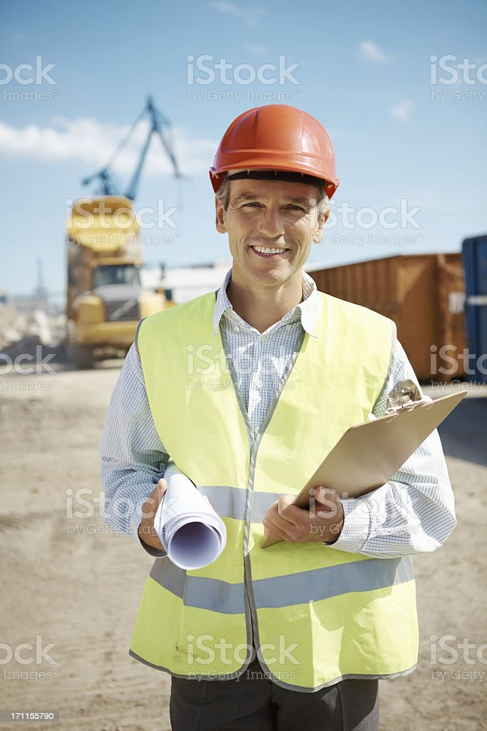 Successful mature engineer at construction site royalty-free stock photo