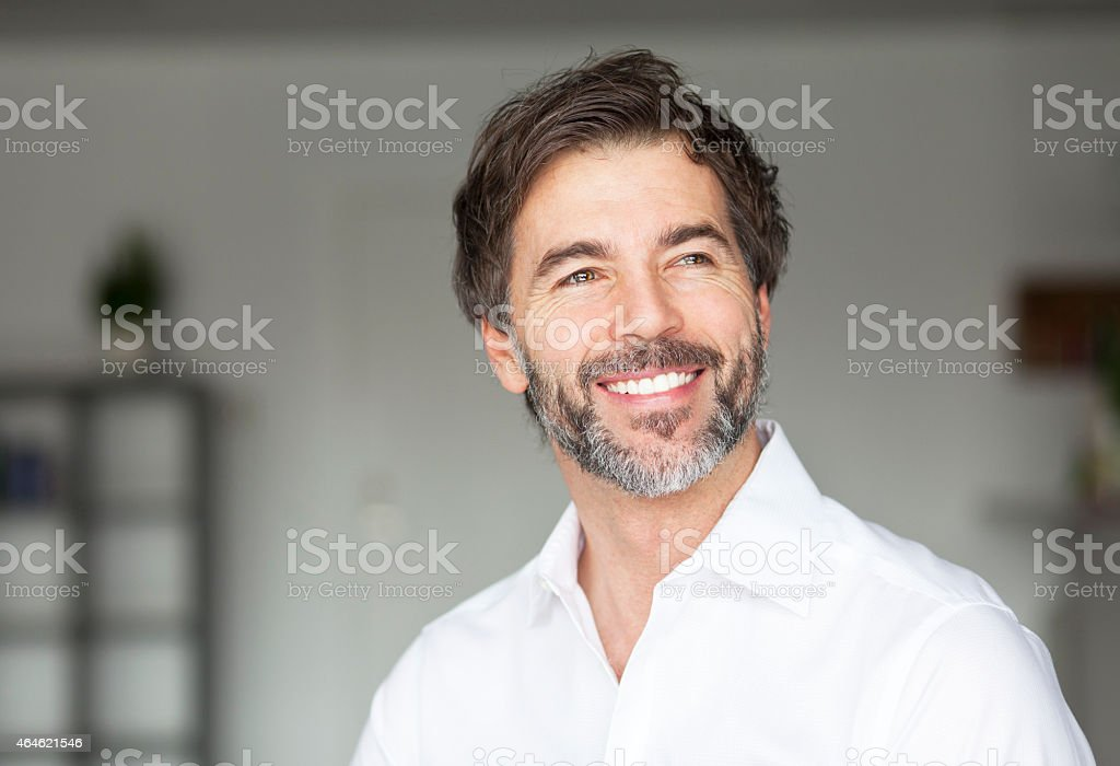 Successful Mature Man Smiling Looking Away stock photo