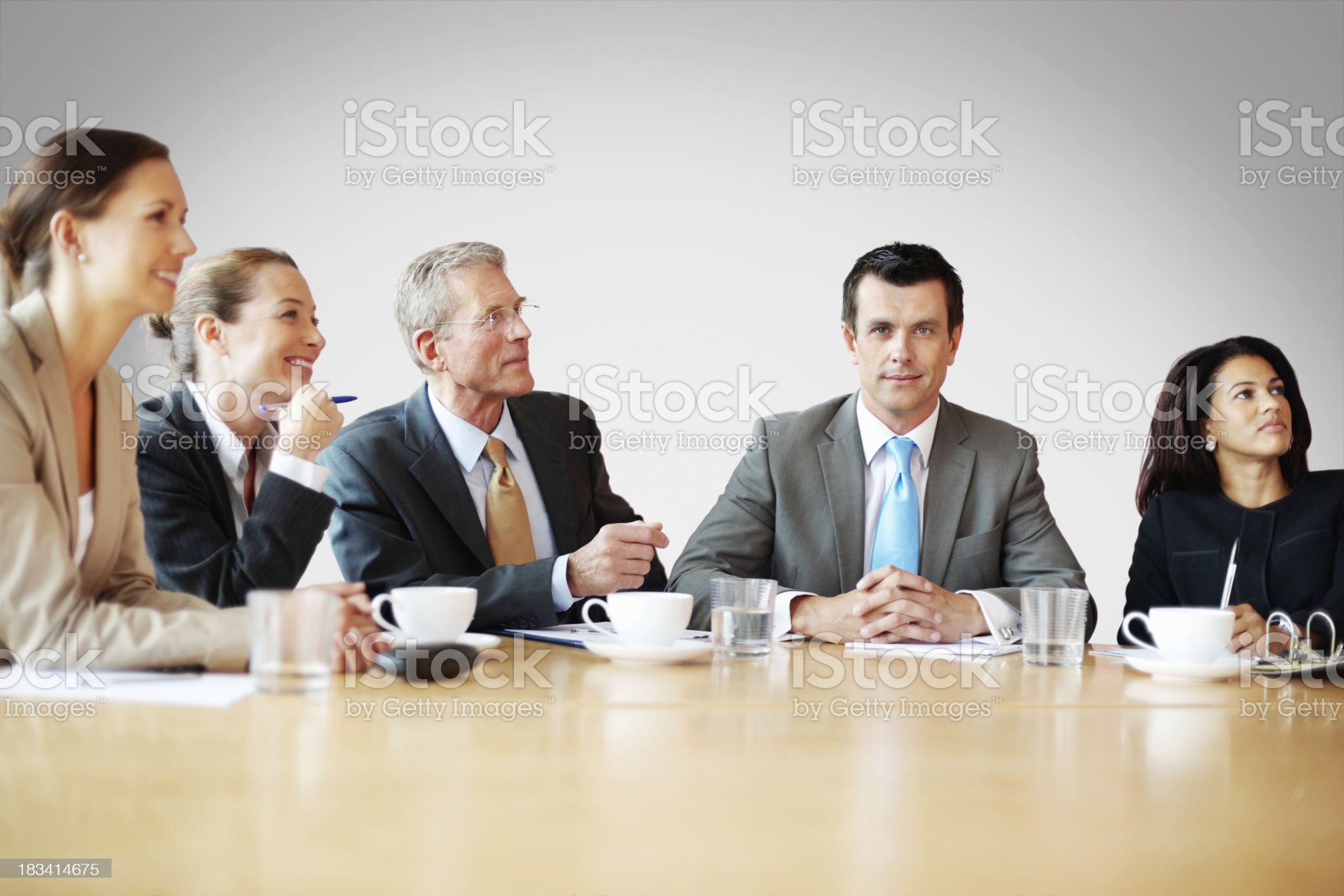 Successful, middle aged man with his team in meeting royalty-free stock photo