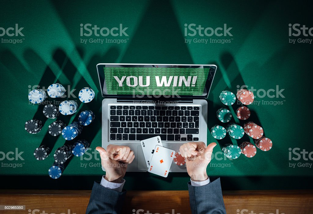 Successful online poker player stock photo